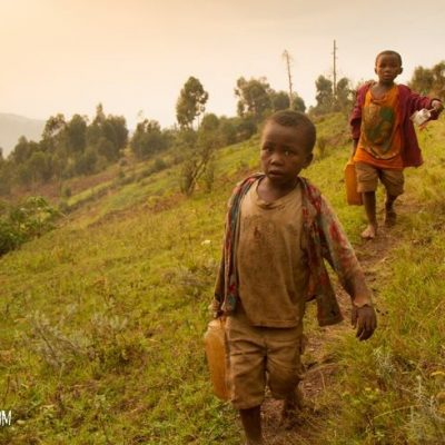 Boys carrying water