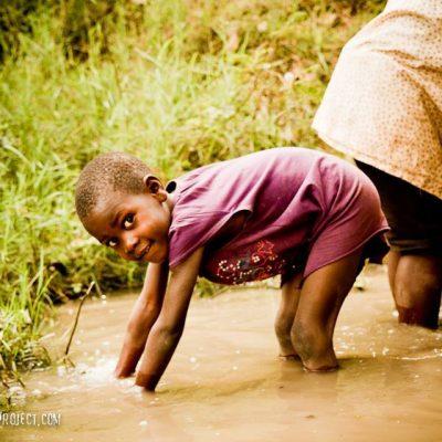 Kalonga Girl Drawing Water